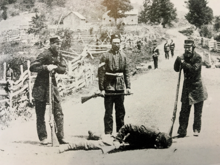 Border Volunteers with slain Fenian at Eccles Hill.